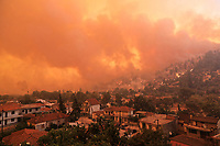 Pictured: Flames surround the village of Gouves in northern Evia siland, Greece. Sunday 08 August 2021<br /> Re: Forest fire in northern Evia, Greece.