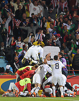 The entire U.S. bench celebrates Landon Donovan's stoppage time goal. The United States won Group C of the 2010 FIFA World Cup in dramatic fashion, 1-0, over Algeria in Pretoria's Loftus Versfeld Stadium, Wednesday, June 23rd..