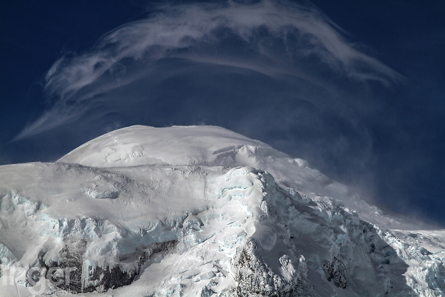 Lenticular clouds forming on the summit of Mawson's Peak, Heard Island