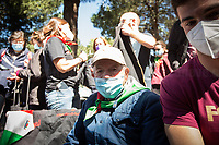 Mario Di Maio, WWII Italian Partizans, Member of the Italian Resistance.<br /> <br /> Rome, Italy. 25th Apr, 2021. Today, to mark the 76th Anniversary of the Italian Liberation from nazi-fascism (Liberazione), Azione Antifascista Roma Est, supported by ANPI Centocelle (National Association of Italian WWII Partizans), and various Antifascist organizations, movements, students, political parties, social centres, held a march (Corteo) from Piazza delle Camelie to Villa Gordiani's Park (1.), in Centocelle's district. The demonstration began with a rally in front of the Memorial dedicated to the Partizans of Centocelle victims of nazi-fascist occupation troops and retaliations, where Partizans and their relatives, activists, historians gave speeches to remember the population struggle and solidarity, to keep the memory and the lesson of the Resistenza alive and to reaffirm the values of Freedom and Justice of the Italian Antifascist Constitution as the only way to fight against fascist pulsions re-appearing all over the world.  <br /> On the 4th June 2018 the Centocelle's District was awarded of the State Gold Medal (for Civil Merit) for its Antifascist Resistance (2.).<br /> <br /> Footnotes & Links: <br /> 1. http://bit.do/fQB69 <br /> 2. http://bit.do/fQB7m <br /> Previous 25 Aprile's Events:<br /> - 25 Aprile 2020: http://bit.do/fQB77 <br /> - I Partigiani http://tiny.cc/cwi3nz<br /> - 25 Aprile 2019 (at Ferramonti di Tarsia concentration camp) http://bit.do/fQB8i <br /> - 25 Aprile 2018 http://tiny.cc/dsi3nz<br /> http://www.anpi.it <br /> (Source, Wikipedia.org ENG) The Liberazione: https://en.wikipedia.org/wiki/Liberation_Day_(Italy)