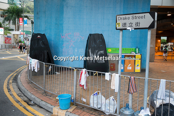 Hong Kong, Government Offices, 1 October 2014<br /> <br /> Students and other supporters of the Occupy Central movement congregating around the government offices area at Tamar. All the roads in the area are blocked from traffic and public transport.<br /> Emergency toilets have been set up.<br /> <br /> Photo Kees Metselaar