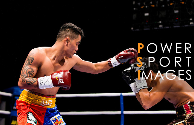 James Murashige of Japan battles Junar Adante of Philippines on their lightweight fight during the Clash of Champions on 14 May 2016 in Hong Kong, China. Photo by Victor Fraile / Power Sport Images