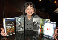 An armful of Canada's best non-fiction books. The 2008 finalists for The Charles Taylor Prize for Literary Non-Fiction were announced Tuesday, January 22nd at a press conference at Le Hotel Meridien King Edward in  Toronto.  CTP is the richest and most prestigious national award for non-fiction in the country.  Noreen Taylor, founder of the prize and chair of the Charles Taylor Foundation has her arms around the five nominated books. In the running for the $25,000 prize which will be announced March 3rd are authors: Kevin Bazzana, David Gilmour, Lorna Goodison, Richard Gwyen and Anna Porter. (CNW Group/Charles Taylor Prize for Literary Non-Fiction)