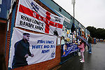 A young fan reading messages of support for Bury FC outside Gigg Lane. 28/08/2019. Gigg Lane, Bury. Photo by Paul Thompson.