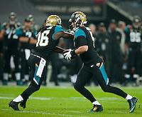 09.11.2014.  London, England.  NFL International Series. Jacksonville Jaguars versus Dallas Cowboys. Jaguars' Chad Henne (#7) hands off to Jaguars' Denard Robinson (#16)