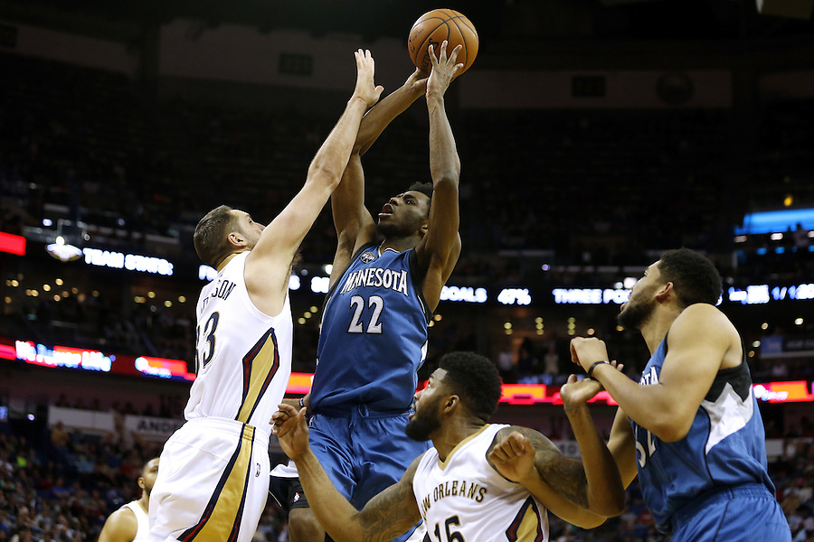 Minnesota Timberwolves guard Andrew Wiggins (22) shoots over New Orleans Pelicans forward Ryan Anderson (33) during the second half of an NBA basketball game Saturday, Feb. 27, 2016, in New Orleans. The Timberwolves won 112-110. (AP Photo/Jonathan Bachman)