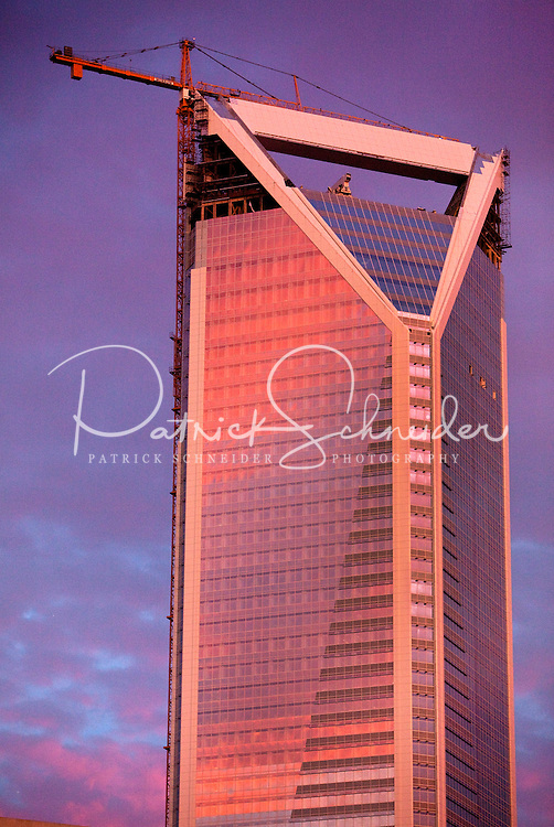 Charlotte, NC's newest skyscraper, the Duke Energy Center, glows in the light of a setting sun during an October 2009 sunset. The Duke center, a 764 foot tall structure is the southern city's second tallest building. Originally conceived as the Wachovia Corporate Center, the building was renamed as the Duke Energy Center after Wells Fargo purchased Wachovia. Batson-Cook Construction and TRC International LTD built the structure, which was completed in late 2009.