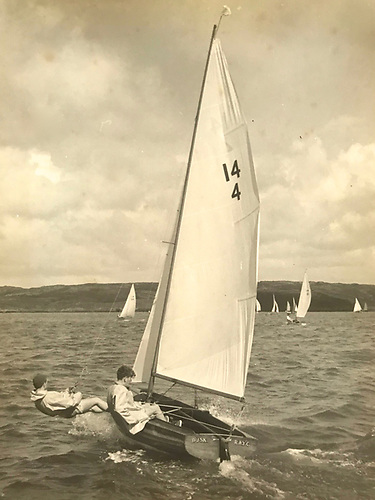 Dusk has been one of the key boats in the IDRA 14 story – she went to Crosshaven in 1954 to become a major player in the Cork Harbour fleet, and is seen here being sailed for what was then the Royal Munster YC by Donal McClement (on trapeze) and the late Dougie Deane in 1961. Later, she returned to Dublin Bay, and in 1993 underwent a complete restoration by Tom and David O'Brien of Dun Laoghaire. Photo: Tom Barker
