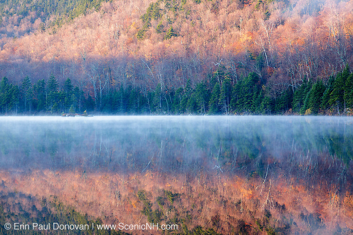 Upper Hall Pond in Sandwich, New Hampshire on a foggy morning. This is a secluded pond located off of Sandwich Notch Road.