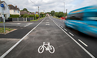 BNPS.co.uk (01202) 558833. <br /> Pic: CorinMesser/BNPS<br /> <br /> A cycle lane which is believed to be one of Britain's widest has been slammed by road users who are bemused by its size.<br /> <br /> Despite measuring over half as wide as the adjacent road, cyclists have still been spotted using the carriageway instead of the cycle lane.<br /> <br /> The cycle way is a whopping 11ft wide, 2ft wider than the vehicle lane which locals say is frequented by heavy goods and emergency vehicles.<br /> <br /> Residents on Wimborne Road West in Wimborne, Dorset, were exasperated when they woke one morning to the 'cycle highway' as it has been dubbed by the local council.<br /> <br /> It is part of a major £102 million scheme to make travel more sustainable and reduce congestion across the county but they argue it could have the opposite effect by obstructing traffic.