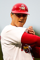 Coach Ron Warner (57) of the Springfield Cardinals gives a pitching sign during a game against the Frisco RoughRiders on April 14, 2011 at Hammons Field in Springfield, Missouri.  Photo By David Welker/Four Seam Images.