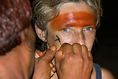 Xingu Indigenous Park, Mato Grosso State, Brazil. Aldeia Waura. Sue Cunningham being painted in the men's meeting house.