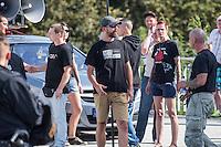 """Nazidemonstration in Frankfurt an der Oder.<br /> Ca. 120 Nazis aus Berlin und Brandenburg zogen am Samstag den 3. September 2016 mit einer Demonstration durch Frankfurt an der Oder. Angekuendigt war der Aufmarsch als grenzuebergreifende Demonstration von deutschen und polnischen Nazis gegen Islam und Fluechtlinge, es nahmen jedoch nur zwei Personen aus Polen teil.<br /> In Redebeitraegen und Parolen wurde gegen die """"Kriminalitaet aus Osteuropa"""" gehetzt und behauptet es faende eine """"gewollte Uberfremdung der deutschen Heimat durch Fluechtlinge"""" statt.<br /> Angefuehrt wurde die Demonstration von der Oderbruecke zum Bahnhof von der rechtsextremen Kleinstpartei """"Der 3. Weg"""". Des Weiteren nahmen Mitglieder von """"unabhaengigen Buergerinitiativen"""" gegen Fluechtlinge, der NPD, sog. Freien Kameradschaften und Mitgliedern der rechtsextremen Gruppe """"Die Identitaeren"""" teil.<br /> Einige Personen einer Gegendemonstration versuchten mit Sitzblockaden die rechtsextreme Demonstration zu verhindern, die Polizei fuehrte die Nazis jedoch an den Blockierern vorbei. Vereinzelt wurden Personen, die versuchten die Demonstrationsroute zu blockieren, von der Polizei mit Tritten und Schlagstockeinsatz von der Strasse vertrieben.<br /> Im der Bildmitte mit schwarzem T-Shirt: Pascal Stolle, """"Der 3. Weg"""". Er war Leiter der Nazidemonstration. Auf seinem T-Shirt steht """"Gute Zeiten 1933 - Schlechte Zeiten 2016"""".<br /> 3.9.2016, Frankfurt an der Oder<br /> Copyright: Christian-Ditsch.de<br /> [Inhaltsveraendernde Manipulation des Fotos nur nach ausdruecklicher Genehmigung des Fotografen. Vereinbarungen ueber Abtretung von Persoenlichkeitsrechten/Model Release der abgebildeten Person/Personen liegen nicht vor. NO MODEL RELEASE! Nur fuer Redaktionelle Zwecke. Don't publish without copyright Christian-Ditsch.de, Veroeffentlichung nur mit Fotografennennung, sowie gegen Honorar, MwSt. und Beleg. Konto: I N G - D i B a, IBAN DE58500105175400192269, BIC INGDDEFFXXX, Kontakt: post@christian-ditsch.de<br /"""