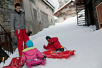 Children sledding on snow-covered village streets in Bonneval sur Arc, Savoie, France, 16 February 2012.