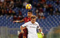 Calcio, Serie A: Roma vs Palermo. Roma, stadio Olimpico, 23 ottobre 2016.<br /> Roma's Emerson Palmieri, left, and Palermo's Alessandro Diamanti jump for the ball during the Italian Serie A football match between Roma and Palermo at Rome's Olympic stadium, 23 October 2016. Roma won 4-1.<br /> UPDATE IMAGES PRESS/Riccardo De Luca