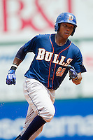 Tim Beckham (22) of the Durham Bulls hustles towards third base against the Charlotte Knights at Knights Stadium on August 18, 2013 in Fort Mill, South Carolina.  The Bulls defeated the Knights 8-5 in Game One of a double-header.  (Brian Westerholt/Four Seam Images)
