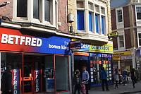 Bet Fred, betting shop is next to the instant cash and lending shop, Cash Generator in Newport, Wales, UK<br /> 26-Sept-13