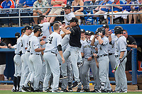 Wake Forest Demon Deacons pitcher John McCarren (rear) leaps into head coach Tom Walter prior to the game against the Florida Gators in Game One of the Gainesville Super Regional of the 2017 College World Series at Alfred McKethan Stadium at Perry Field on June 10, 2017 in Gainesville, Florida.  (Brian Westerholt/Four Seam Images)