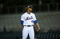 Scottsdale Scorpions relief pitcher Gerson Bautista (46), of the New York Mets organization, looks in for the sign during an Arizona Fall League game against the Mesa Solar Sox on October 9, 2018 at Scottsdale Stadium in Scottsdale, Arizona. The Solar Sox defeated the Scorpions 4-3. (Zachary Lucy/Four Seam Images)