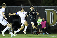 WINSTON-SALEM, NC - DECEMBER 07: Kyle Holcomb #3 of Wake Forest University and Faouzi Taieb #5 of the University of California Santa Barbara challenge for the ball during a game between UC Santa Barbara and Wake Forest at W. Dennie Spry Stadium on December 07, 2019 in Winston-Salem, North Carolina.