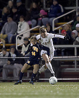 """Boston College forward Brooke Knowlton (16) on the attack as West Virginia forward Chelsey Corroto (14) defends. Boston College defeated West Virginia, 4-0, in NCAA tournament """"Sweet 16"""" match at Newton Soccer Field, Newton, MA."""