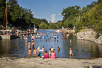 Barton Springs Pool is a super fun and relaxing natural swimming pool located on the grounds of Zilker Park in Austin, Texas. The pool exists in the channel of Barton Creek and is filled by water from Main Barton Spring, the fourth largest spring in Texas.