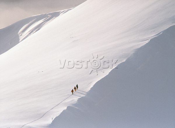 Trekking up snowy mountain