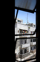 A view through a window of a Bauhaus style building at 25 Rosh Pina Street built by architect Arieh Cohen in 1935. Tel Aviv is known as the White City in reference to its collection of 4,000 Bauhaus style buildings, the largest number in any city in the world. In 2003 the Bauhaus neighbourhoods of Tel Aviv were placed on the UNESCO World Heritage List. .