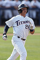 Greg Velazquez #24 of the Cal State Fullerton Titans runs the bases against the Washington State Cougars at Goodwin Field on  February 15, 2014 in Fullerton, California. Washington State defeated Fullerton, 9-7. (Larry Goren/Four Seam Images)