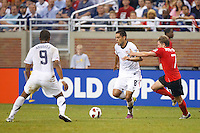 7 June 2011: USA Men's National Team forward Clint Dempsey (8) dribbles the ball past Canada midfielder Terry Dunfield (7) during the CONCACAF soccer match between USA MNT and Canada MNT at Ford Field Detroit, Michigan. USA won 2-0.