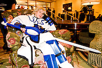 """Tara, cos-playing as Kykiske, takes a break in the hotel lobby at the 12th annual Katsucon, a convention for fans of Japanese comics, animation (anime), and video games, held in Washington D.C. on February 18, 2006 and attended by over 8,000 people.<br /> <br /> Cosplay, short for """"costume play"""", is the act of creating and wearing outfits of one's favorite anime, comic, or video game and often acting out that characters actions."""