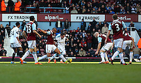 Pictured: Pablo Hernandez of Swansea (C in white) is challenged by two West Ham players. 01 February 2014<br /> Re: Barclay's Premier League, West Ham United v Swansea City FC at Boleyn Ground, London.