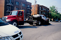 Montreal (QC) CANADA - June 206   File Photo - a police car get  towed after a traffic accident