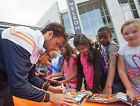 September 11, 2014, Netherlands, Amsterdam, Ziggo Dome, Davis Cup Netherlands-Croatia, Draw, Dutch players playing street tennis with kids in front off City Hall, pictured: Robin Haase signing autographs <br /> Photo: Tennisimages/Henk Koster