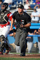 Home plate umpire Sam Vogt gets in position to make a call during a game between the Batavia Muckdogs and Connecticut Tigers at Dwyer Stadium on July 5, 2012 in Batavia, New York.  Batavia defeated Connecticut 8-2.  (Mike Janes/Four Seam Images)