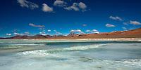 Frozen Salar de Tara lagoon, Aquas Callientes, with the Licancabur Volcano in the Atacama Desert, at the border of Chile, Argentina and Bolivia