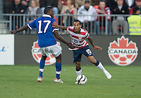 03 June 2012: US Men's National Soccer Team defender Edgar Castillo  #15 and Canadian Men's National Soccer Team forward Olivier Occean  #17 in action during an international friendly  match between the United States Men's National Soccer Team and the Canadian Men's National Soccer Team at BMO Field in Toronto..The game ended in 0-0 draw..