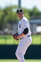 Glendale Desert Dogs relief pitcher Jordan Foley (36), of the New York Yankees organization, gets ready to deliver a pitch during an Arizona Fall League game against the Mesa Solar Sox at Camelback Ranch on October 15, 2018 in Glendale, Arizona. Mesa defeated Glendale 8-0. (Zachary Lucy/Four Seam Images)