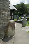 St Twrogs Church Maentwrog  Gwynedd Wales. A 6th century church with Neolithic standing stone by porch, this is now called the Maen Twrog, maen means in Welsh Stone.<br /> <br /> Maen Twrog, maen means in Welsh Stone.