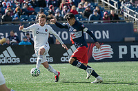 FOXBOROUGH, MA - MARCH 7: Djordje Mihailovic #14 of Chicago Fire breaks away from Gustavo Bou #7 of New England Revolution during a game between Chicago Fire and New England Revolution at Gillette Stadium on March 7, 2020 in Foxborough, Massachusetts.