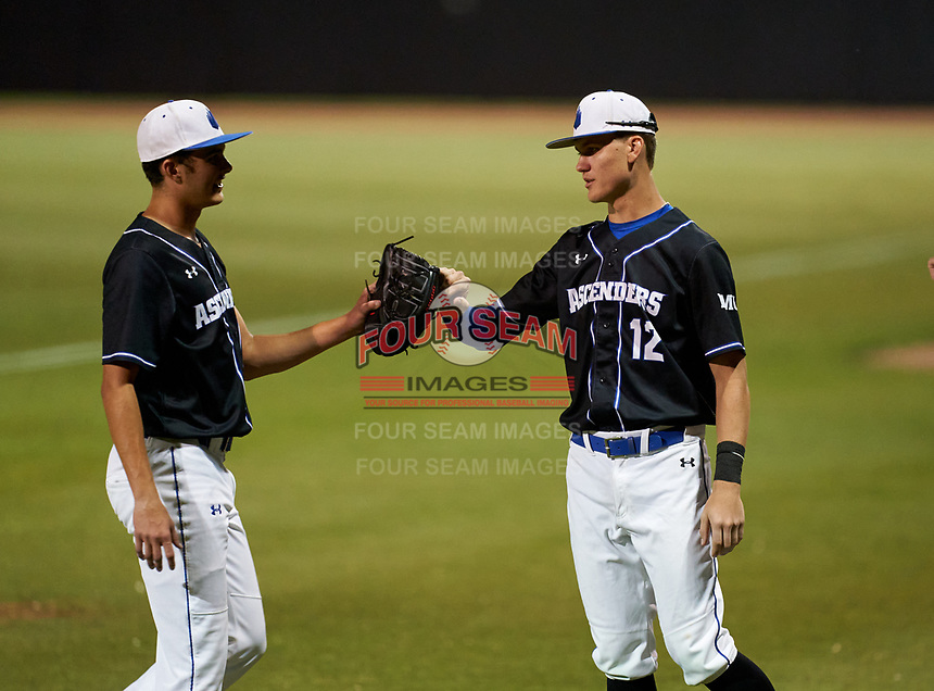 IMG Academy Ascenders pitcher Jackson Ferris (10) fist bumps Blaydon Plain (12) during a game against the Canterbury Cougars on April 21, 2021 at IMG Academy in Bradenton, Florida.  (Mike Janes/Four Seam Images)