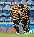 Alloa's Ryan McCord (8) is congratulated by Jonathan Tiffoney after he scores their second goal from the spot.