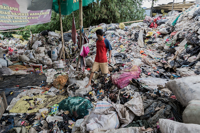 29 JAN, 2018, Bandung, Indonesia: Rubbish collector Mulyanto ,at a recycle collection point where river scavengers come to deposit the trash collected from the Citarum river. The Citarum river, listed as one of the most polluted rivers in the world.  It will soon be the main water supply system for Jakarta as the bores that have been dug into the aquifers dry but it also supports agriculture, fishery, industry, sewerage and electricity.  The Indonesian Government is moving to urgently try to clean the system up but it is fighting massive infrastructure issues and toxic industrial dumping.    Picture by Graham Crouch/The Australian