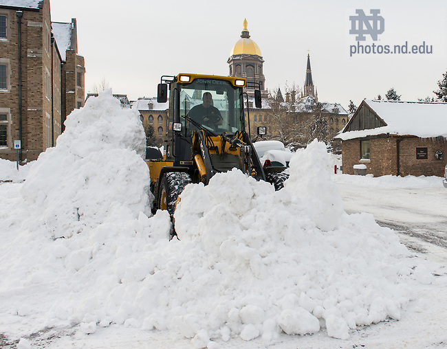 Jan. 8, 2014; Grounds crew works  on snow removal after a heavy snowfall which closed the University for a day and a half.<br /> <br /> Photo by Matt Cashore/University of Notre Dame