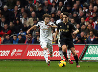 Wednesday, 01 January 2014<br /> Pictured L-R: Jose Canas of Swansea against Samir Nasri of Manchester City. <br /> Re: Barclay's Premier League, Swansea City FC v Manchester City at the Liberty Stadium, south Wales.