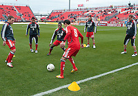 14 April 2012: Toronto FC players kick the ball around during the warm-up in a game between Chivas USA and Toronto FC at BMO Field in Toronto..Chivas USA won 1-0. .