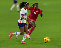 ORLANDO CITY, FL - FEBRUARY 18: Margaret Purce #20 is pressured by Deanna Rose #6 during a game between Canada and USWNT at Exploria stadium on February 18, 2021 in Orlando City, Florida.