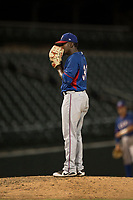 AZL Rangers relief pitcher Ediberto Encarnacion (31) looks in for the sign during an Arizona League game against the AZL Cubs 2 at Sloan Park on July 7, 2018 in Mesa, Arizona. AZL Rangers defeated AZL Cubs 2 11-2. (Zachary Lucy/Four Seam Images)