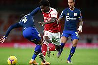 17th December 2020, Emirates Stadium, London, England;  Arsenals Bukayo Saka  goes past Southamptons Kyle Walker-Peters during the English Premier League match between Arsenal and Southampton