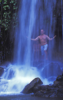 Men at a waterfall on the Kalihiwai River, North Shore of Kauai
